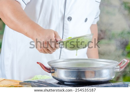 chef cooking for asian food menu name noodle - stock photo