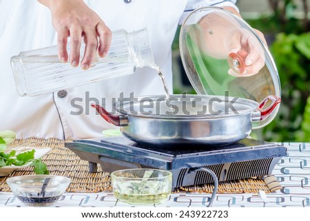 Chef cooking in the kitchen. - stock photo