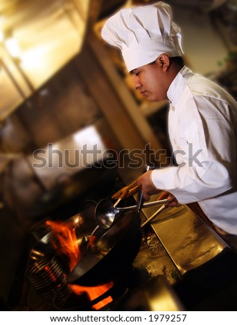 chef cooking looking from side - stock photo