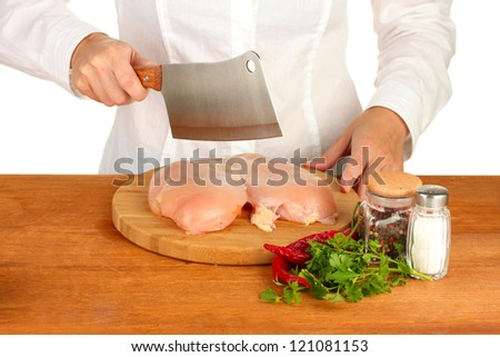 Chef cooking meat on wooden table - stock photo
