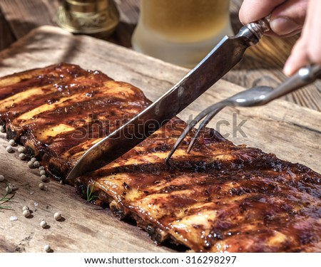 Chef cut up barbecue ribs - stock photo