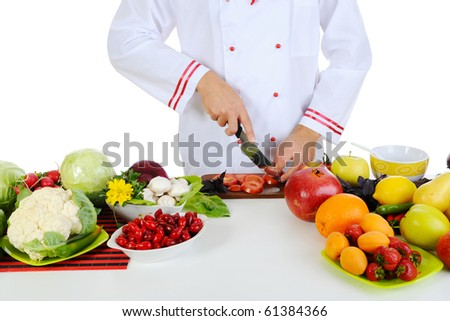 Chef cuts the vegetables. Isolated on white - stock photo