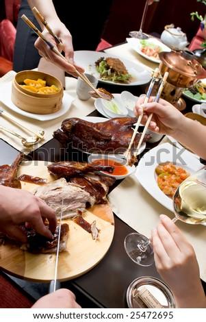 Chef cutting duck in chineese restaurant - stock photo