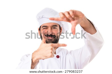 Chef focusing with his fingers on a white background - stock photo