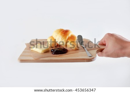 Chef hand serving breakfast on chopping board - stock photo