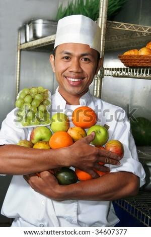 chef holding fruit - stock photo