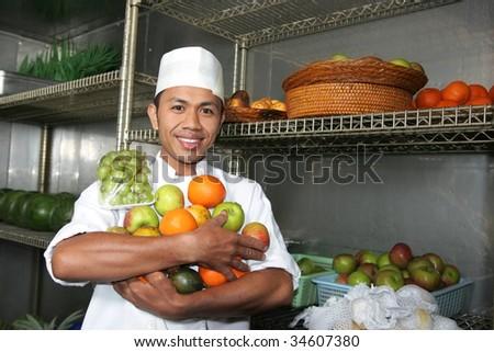 chef holding fruits - stock photo
