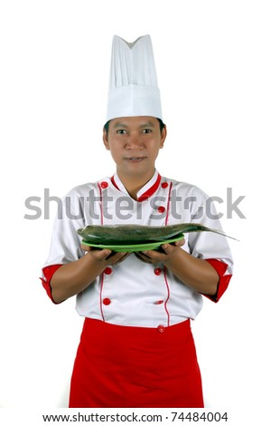 chef holding raw fish on a green plate isolated on white background - stock photo