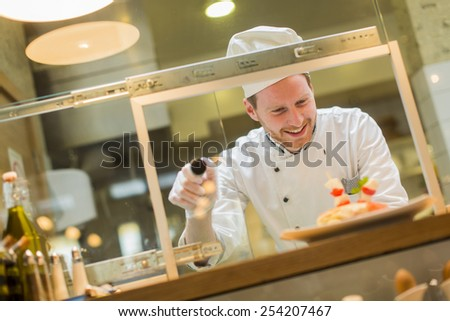 Chef in the restaurant - stock photo