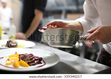 Chef is preparing appetizer on kitchen  - stock photo