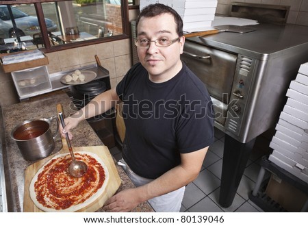 Chef making a pizza - stock photo