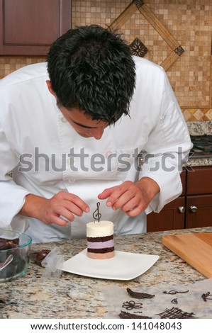 Chef making mousse cake and decorating - stock photo