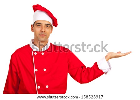 Chef man welcoming there isolated on white background - stock photo
