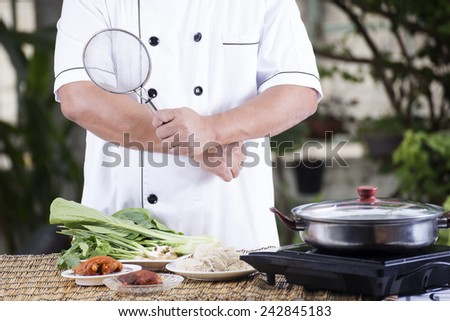 Chef prepared cooking with noodle ingredient / Cooking Noodle concept - stock photo