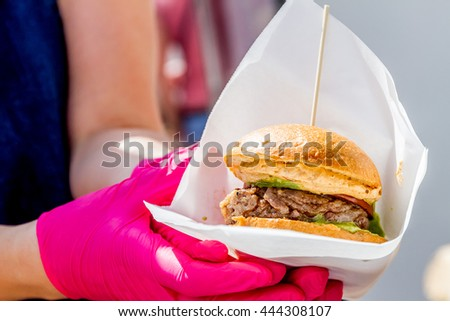 chef preparing a gourmet burger - stock photo