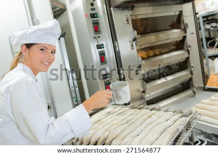 Chef preparing baguettes - stock photo