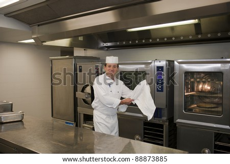 Chef preparing food in restaurant kitchen - stock photo