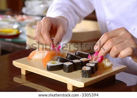 Chef preparing sushi - stock photo