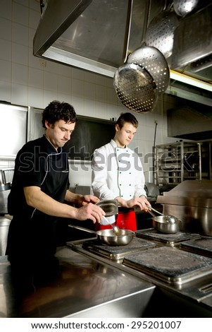 chef restaurant keeps food for hotel guests/chef restaurant keeps food for hotel guests - stock photo