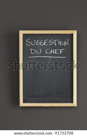 Chef's suggestion sketched on chalkboard - stock photo