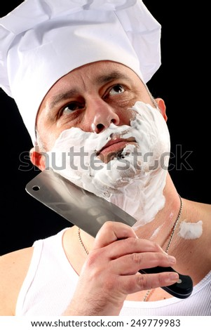 chef shaves with chopper over black - stock photo