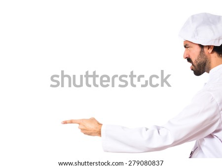 Chef shouting and pointing over white background - stock photo