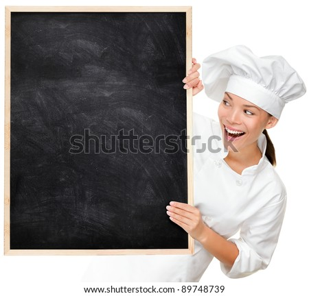 Chef showing blank menu sign blackboard. Woman Cook or baker looking happy and excited wearing chef uniform. Multicultural Asian Caucasian young female chef isolated on white background. - stock photo