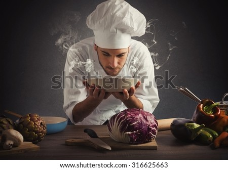 Chef smelling the aroma of a dish - stock photo