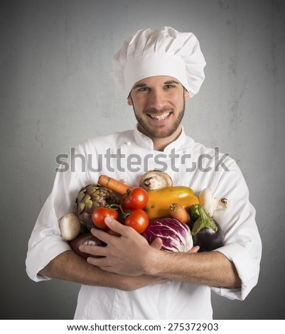 Chef specialized in vegetarian with fresh vegetables - stock photo