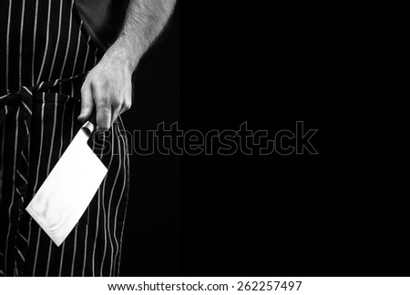chef with a knife and apron  - stock photo