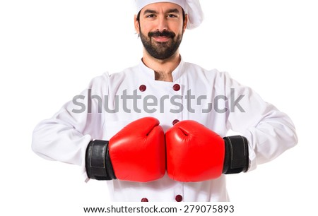 Chef with boxing gloves over white background - stock photo