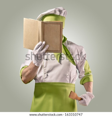 chef with cook book - stock photo