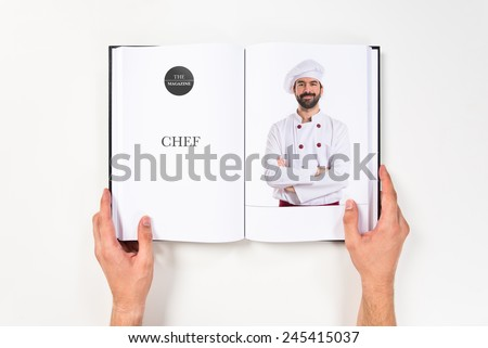 Chef with his arms crossed printed on book - stock photo