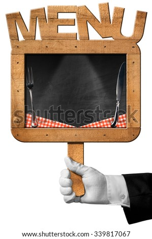 Chef with Old Blackboard with Text Menu / Hand of chef with white glove holding an old empty blackboard with wooden frame with text menu, silver cutlery and checkered tablecloth - stock photo