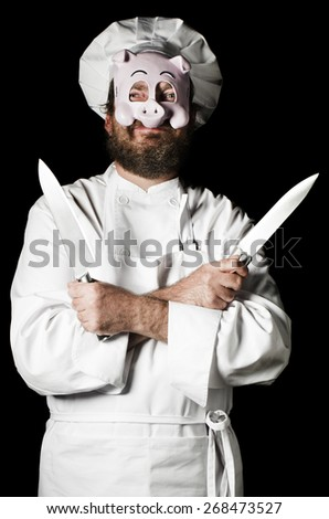 Chef with pig mask and set of knifes - stock photo