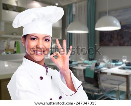 Chef woman in the modern kitchen - stock photo