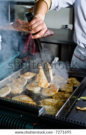 Chef working at restaurant - stock photo