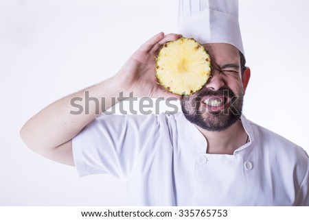 cheff with a pineapple - stock photo