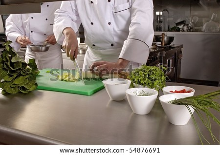 Chefs Cooking, Cutting and preparing  next plate - stock photo