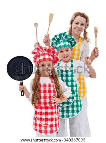 Chefs team ready to cook - kids and their mother holding kitchen utensils - stock photo