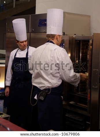 Chefs using new oven - stock photo