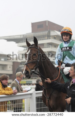 CHELTENHAM, GLOUCS, APRIL 17 2009: Liam Treadwell rides Theoprastus out to the second race at the April National Hunt Meeting at Cheltenham Racecourse, UK - stock photo