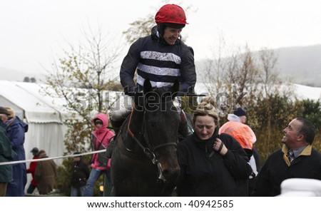 CHELTENHAM, GLOUCS; NOV 14: jockey Richard Johnson rides Trumpstoo back from the first race at Cheltenham Racecourse, UK, November 14, 2009 in Cheltenham, Gloucs - stock photo