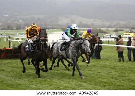 CHELTENHAM, GLOUCS; NOV 14: jockeys timmy murphy and ruby walsh battle to win in the fifth race at Cheltenham Racecourse, UK, November 14, 2009 in Cheltenham, Gloucs - stock photo