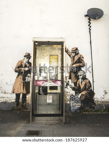 CHELTENHAM UK - APRIL 16, 2014 - Street art on wall in Cheltenham, possibly Banksy - GCHQ theme - stock photo