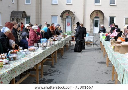 CHELYABINSK - APRIL 23: Church ceremony of consecration of Easter cakes and eggs for Easter Christ's in Russia .April 23, 2011, Chelyabinsk, Russia - stock photo