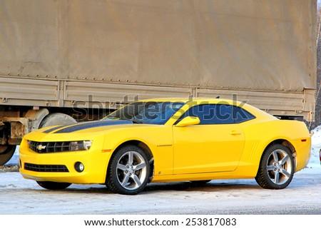 CHELYABINSK REGION, RUSSIA - JANUARY 4, 2012: Brand new muscle car Chevrolet Camaro at the interurban road. - stock photo