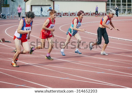 Chelyabinsk, Russia - August 28, 2015:  old women run 100 meters during championship of Russia on track and field athletics among the elderly, Chelyabinsk, Russia - August 28, 2015 - stock photo
