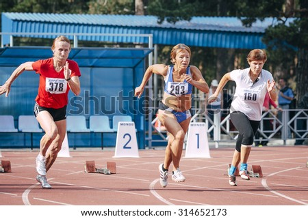 Chelyabinsk, Russia - August 28, 2015:  old women's start at 100 meters during championship of Russia on track and field athletics among the elderly, Chelyabinsk, Russia - August 28, 2015 - stock photo
