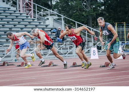 Chelyabinsk, Russia - August 28, 2015:  start of old men's 100 meters during championship of Russia on track and field athletics among the elderly, Chelyabinsk, Russia - August 28, 2015 - stock photo